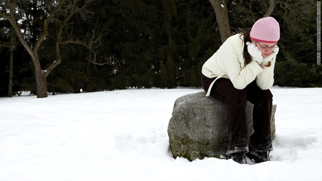 Girl on rock in snow